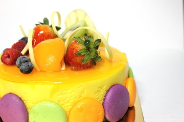 peach mousse cake and topped with fresh fruit.