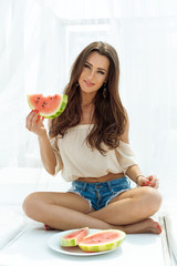 Young beauty woman holding watermelon in her hand