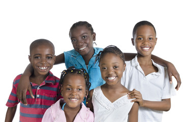 Five happy african kids holding one another