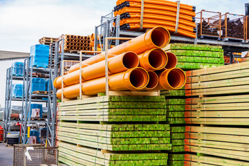 Several pipes stacked in yard