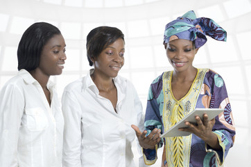 Three african business women with tablet PC