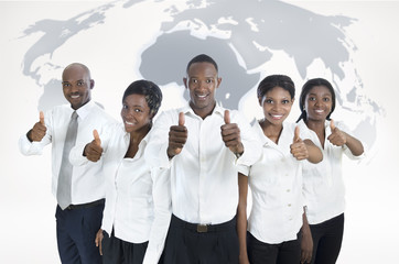 African business team with world map, thumbs up