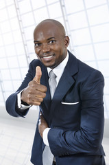 African business man thumb up