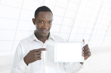 African business man presenting tablet PC