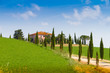 Country house with cypress in Tuscany, Italy