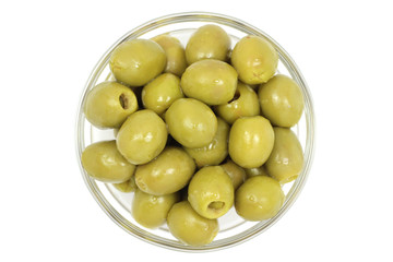 Juicy stuffed olives in a glass on white background