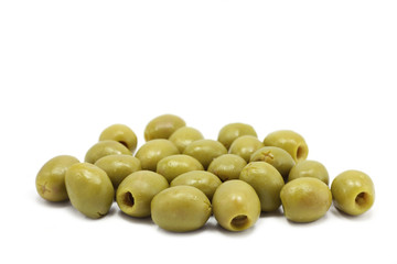a few green olives on white background