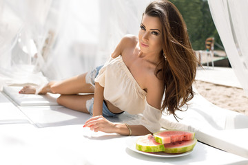 Fashion portrait with a beautiful girl with watermelon