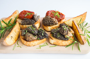 toast with morel mushrooms and tomato