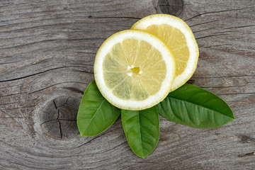 Fresh sliced lemon on wooden table. Top view.