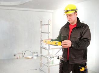 Contractor worker with helmet planning building process