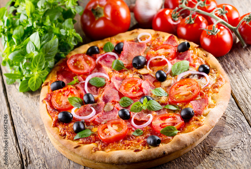 pizza with ham, olives and vegetables - 66676246