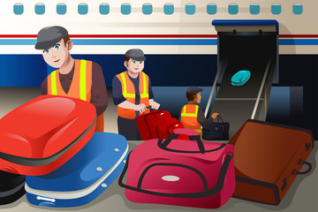 Workers loading luggage into an airplane in the airport