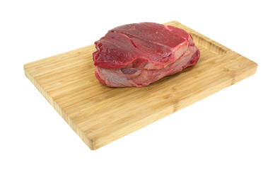 Chuck roast on a wood cutting board