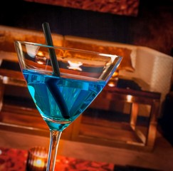 detail of blue cocktail drink on a lounge bar table