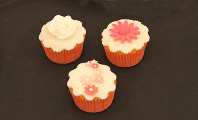 Three Pretty Individual Home Made Cup Cakes.