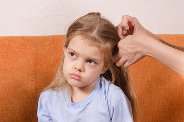 Mom upset girl hair braids