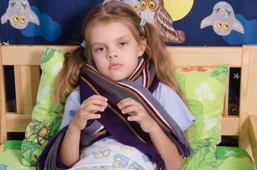 Diseased five year old girl lying in bed