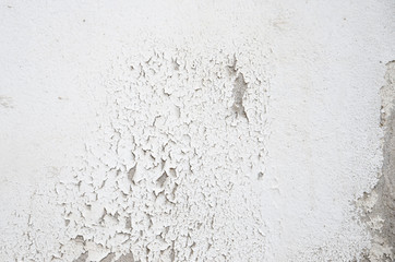 White painted concrete wall surface crack.