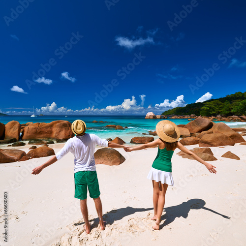 Couple in green on a beach at Seychelles - 66680600