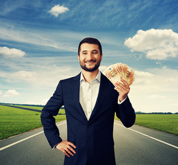 businessman holding money at outdoor
