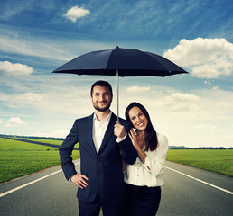 couple under black umbrella at outdoor