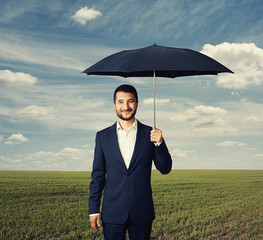 man under umbrella at outdoor