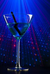 blue cocktail drink in a disco with space for text