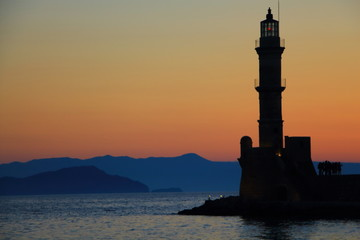 Dusk at harbor with lighthouse Chania Crete