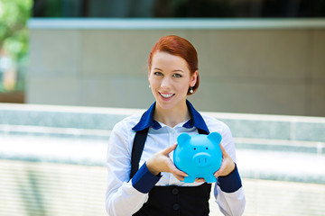 Happy woman, corporate employee holding piggy bank