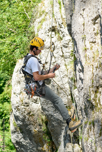 canvas print picture steeplejack climbing a rock wall