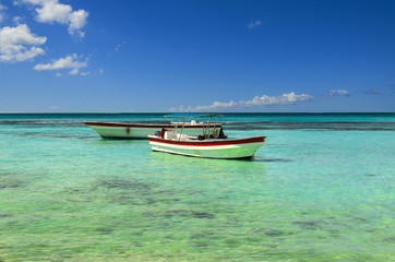 Boats on the azure sea on a background of blue sky