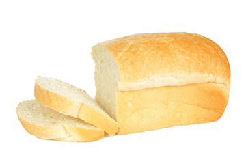 Loaf of bread with think cut slices isolated on white