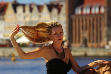 Stylish blonde woman in old town Gdansk