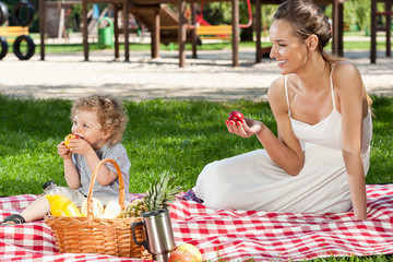 Mother and baby having picnic