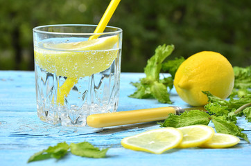 Gassed water with lemon.