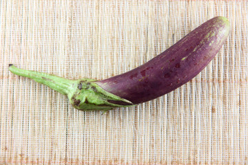 purple eggplant on bamboo pattern background.