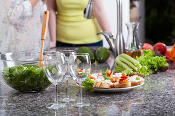 Wine glasses and food for a party