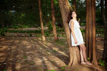 Beautiful romantic woman in forest