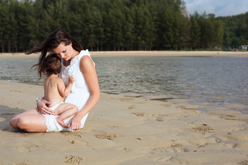 Mother and child enjoying time at tropical beach