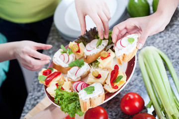 Female hands reaching out for a healthy sandwiches