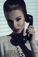 woman talking on vintage phone
