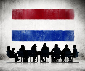 Business People in a Meeting with Flag of Netherlands