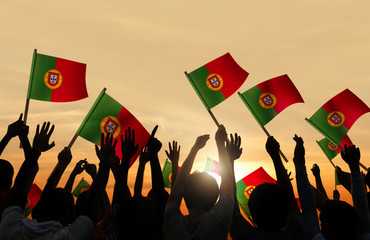 Silhouettes of Peopel Holding Portuguese Flags
