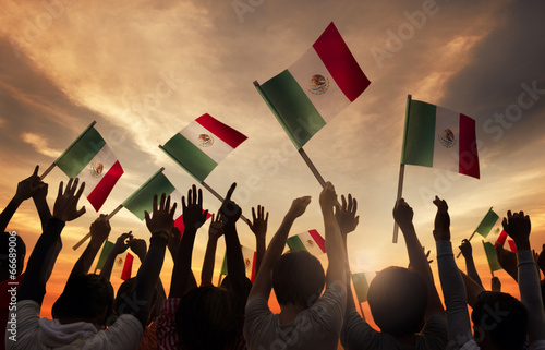 Leinwanddruck Bild Group of People Holding National Flags of Mexico