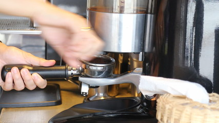 Barista Making Ground Coffee With Coffee Grinder