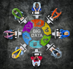 People in a Circle Using Computer with Big Data Concept