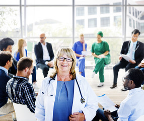Female Doctor Standing in Front of a Support Group