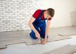 Young handsome men laid laminate floor covering, perform repairs - 66690809