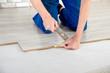 Young handsome men laid laminate floor covering, perform repairs - 66690814